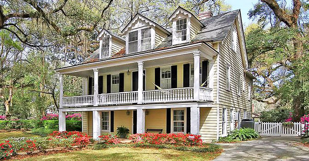 Double decker farmhouse is overflowing with old fashioned Old country farmhouse